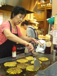 The friendly staff of Takohachi cooking chijimi